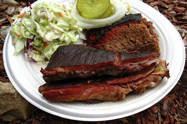 """Owners of barbecue joints across the state are fuming over wording state Agriculture Commissioner Sid Miller added to the so-called """"BBQ Bill."""""""