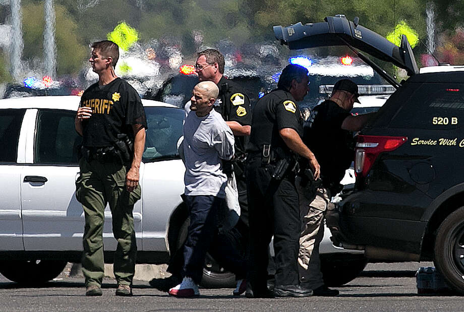 A suspect believed to be involved in the shooting of law enforcement officers is taken from the scene by Sacramento County Sheriff's Deputies, Wednesday, Aug. 30, 2017, in Sacramento, Calif. Photo: Rich Pedroncelli, AP / Copyright 2017 The Associated Press. All rights reserved.
