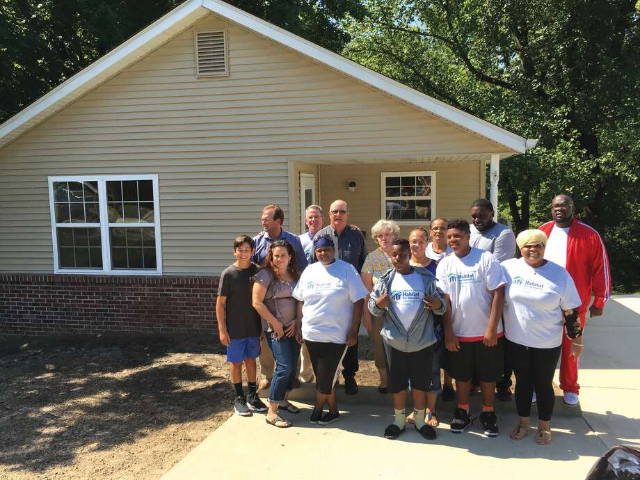 Members of the Edwardsville/Glen Carbon Chapter of Habitat for Humanity stand with the Wilson Family, who received a house at 310 M St. in Edwardsville. Photo: Steve Horrell • Shorrell@edwpub.net