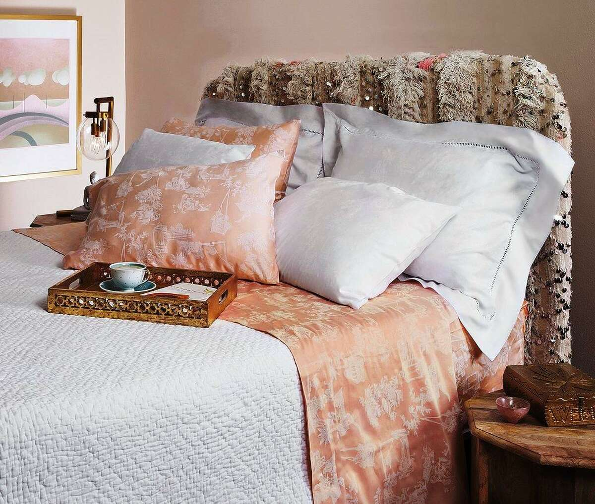 Dawson + Hellmann printed bedding comes in baby pink with a Kama Sutra pattern.