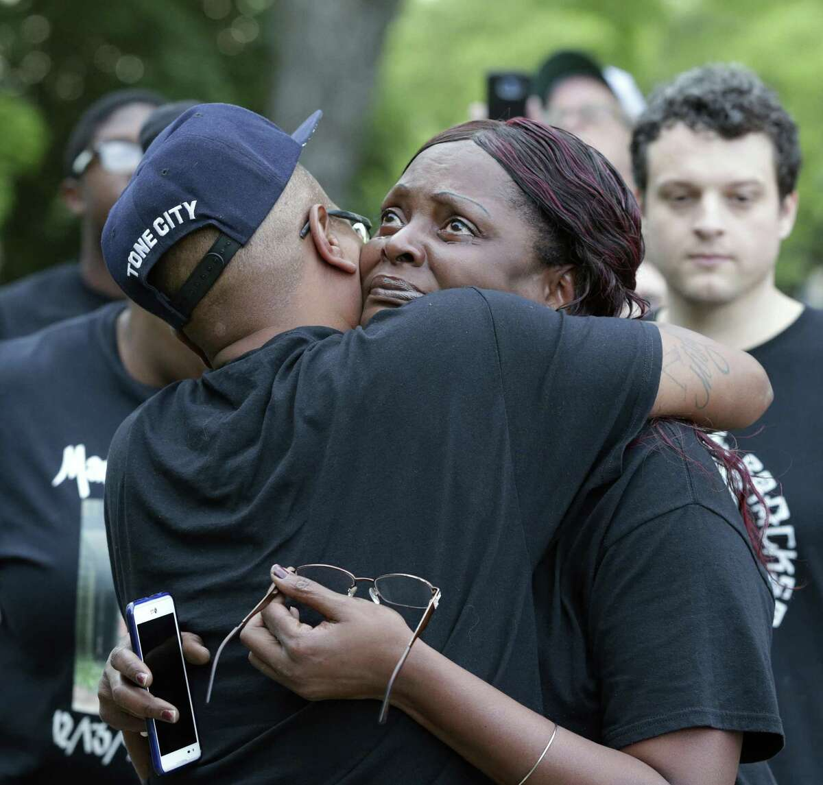 Mother of the deceased Cheryle Jones stares at the courthouse as she gets a hug from Derrick Williams before Mike Lowe leads a rally protesting the court decision to exonerate officer Robert Encina on April 6, 2017.