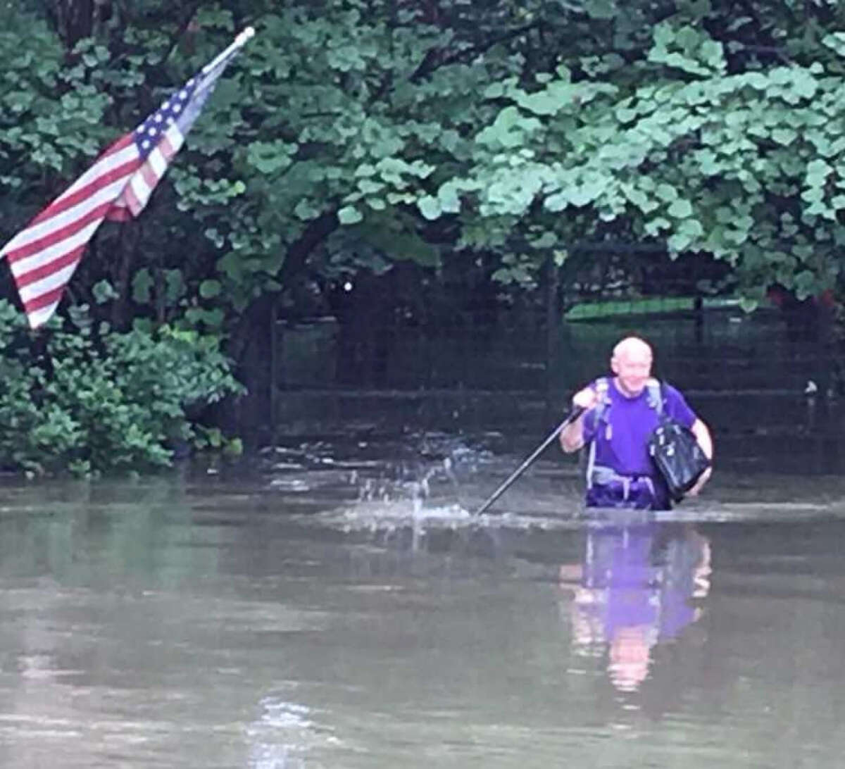 Former Houston mayor Bill White escapes his home moments after it floods on Sunday. MUST CREDIT: Courtesy of Bill White