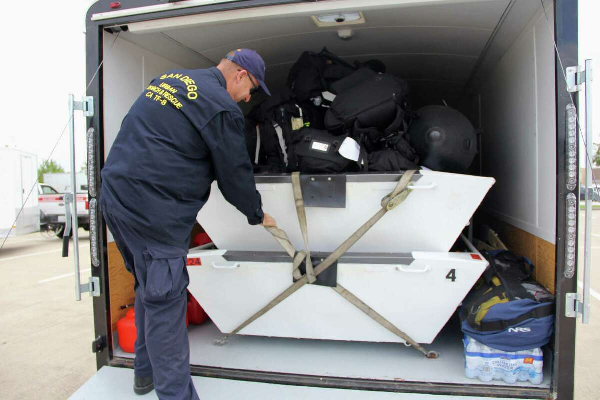 Lane Woolery, chief of the San Diego Urban Search & Rescue Task Force 8, checks on the teams search and rescue equipment on Aug. 30. Equipment for the task force includes trailers with four wide, flat bottom aluminum boats, two rubber boats, motors for the boats, concrete breaking and breaching equipment, power supplies to cut through various solid materials, rope for rescues, and tools to respond to chemical biological nuclear events.