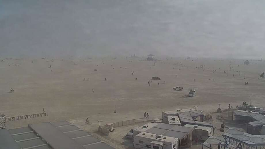 A view of Burning Man from a life web cam on Aug. 31, 2017 shows a smokey haze from the Tohakum 2 Fire burning near Pyramid Lake, about 40 miles southwest of the festival. Photo: BurningMan.org