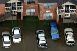 Hurricane Harvey floodwaters surround an apartment complex. State Farm has received more than 32,000 Harvey-related auto claims.