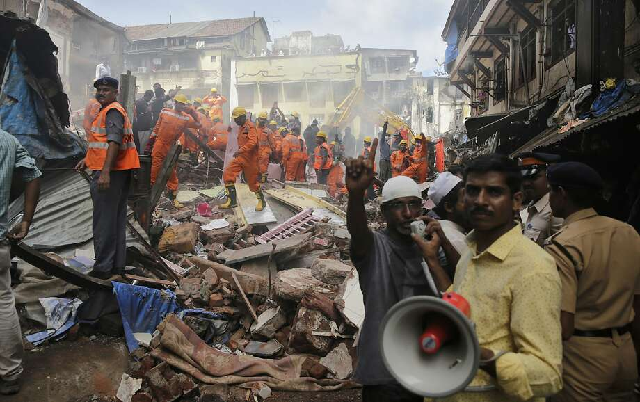 Rescue workers search for survivors at the site of the collapse of a five-story apartment building in Mumbai, India's financial capital. Photo: Rafiq Maqbool, Associated Press