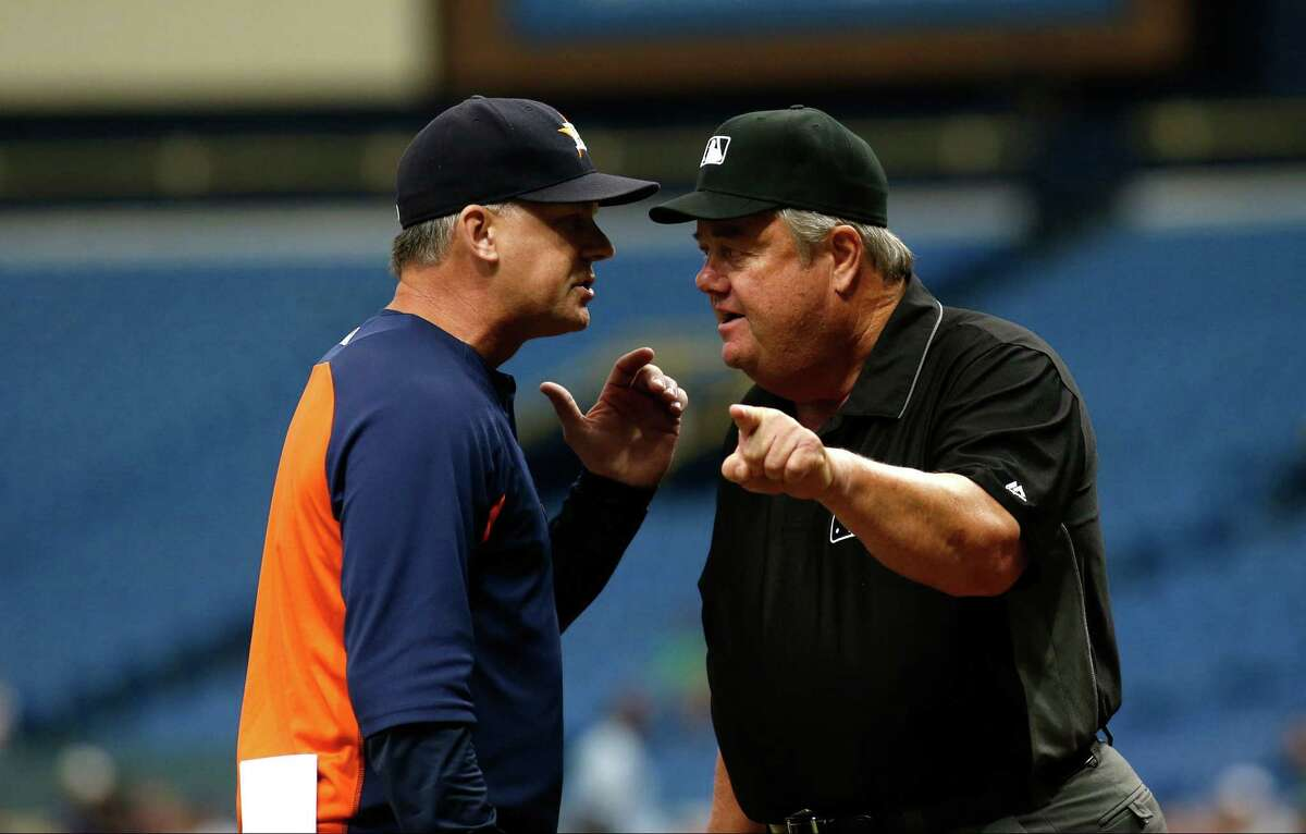 ST. PETERSBURG, FL - AUGUST 31: A.J. Hinch #14 of the Houston Astros has an exchanged with umpire Joe West #22 moments after West ejected Hinch during the first inning of a game on August 31, 2017 at Tropicana Field in St. Petersburg, Florida.