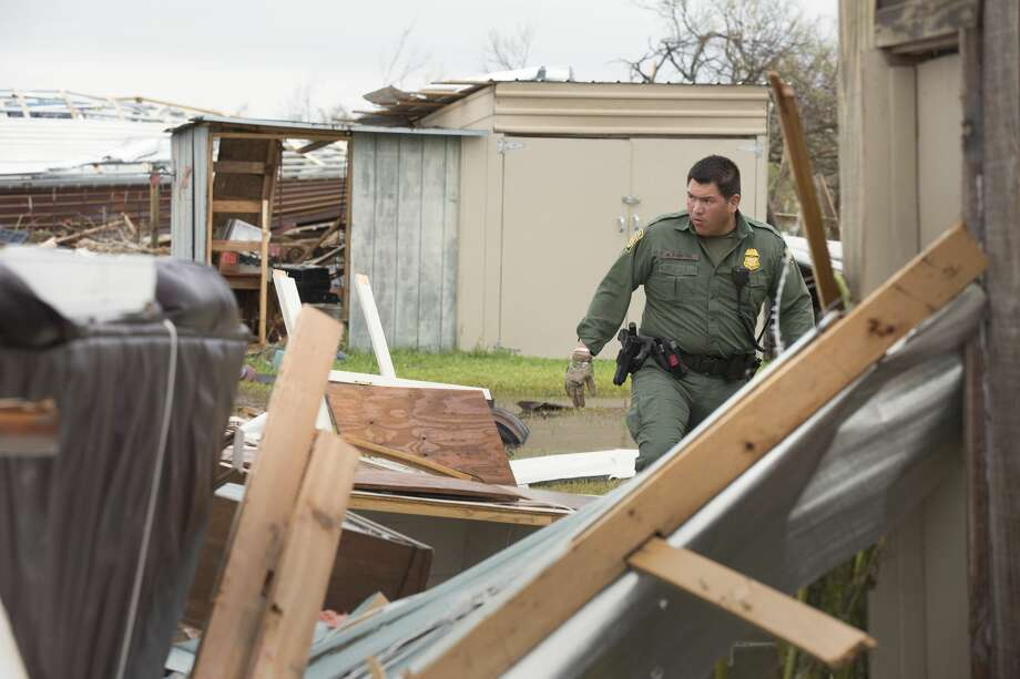 U.S Border Patrol agent Mario Fuentes searches for survivors among the rubble of a mobile home after Hurricane Harvey near Rockport, Texas, Aug. 27, 2017. Photo: Contributed Photo/Glenn Fawcett