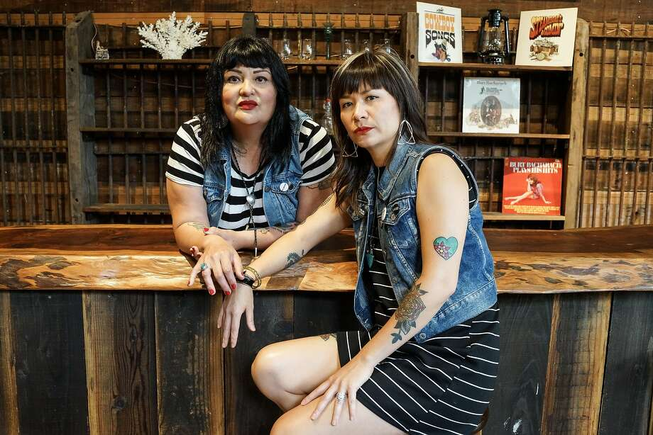 Dulcinea Gonzalez (guitar) and Camylle Reynolds (bass), members of the punk band Midnite Snaxxx photographed by Henny Garfunkel at Amado's record store and performance venue on Valencia St. Photo: Henny Garfunkel, Special To The Chronicle