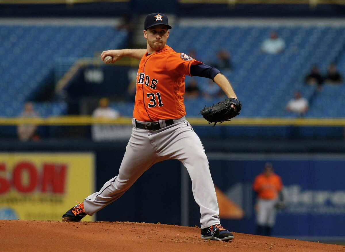 ST. PETERSBURG, FL - AUGUST 31: Pitcher Collin McHugh #31 of the Houston Astros pitches during the first inning of a game against the Texas Rangers on August 31, 2017 at Tropicana Field in St. Petersburg, Florida.