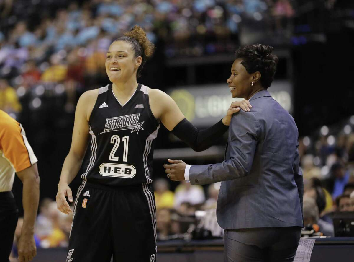 In this July 12, 2017, file photo, San Antonio Stars' Kayla McBride laughs with head coach Vickie Johnson during the second half of a WNBA basketball game against the Indiana Fever, in Indianapolis.