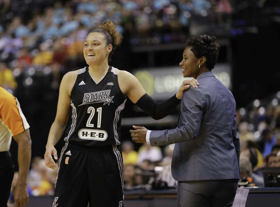 In this July 12, 2017, file photo, San Antonio Stars' Kayla McBride laughs with head coach Vickie Johnson during the second half of a WNBA basketball game against the Indiana Fever, in Indianapolis. Photo: Darron Cummings /Associated Press / Copyright 2017 The Associated Press. All rights reserved.