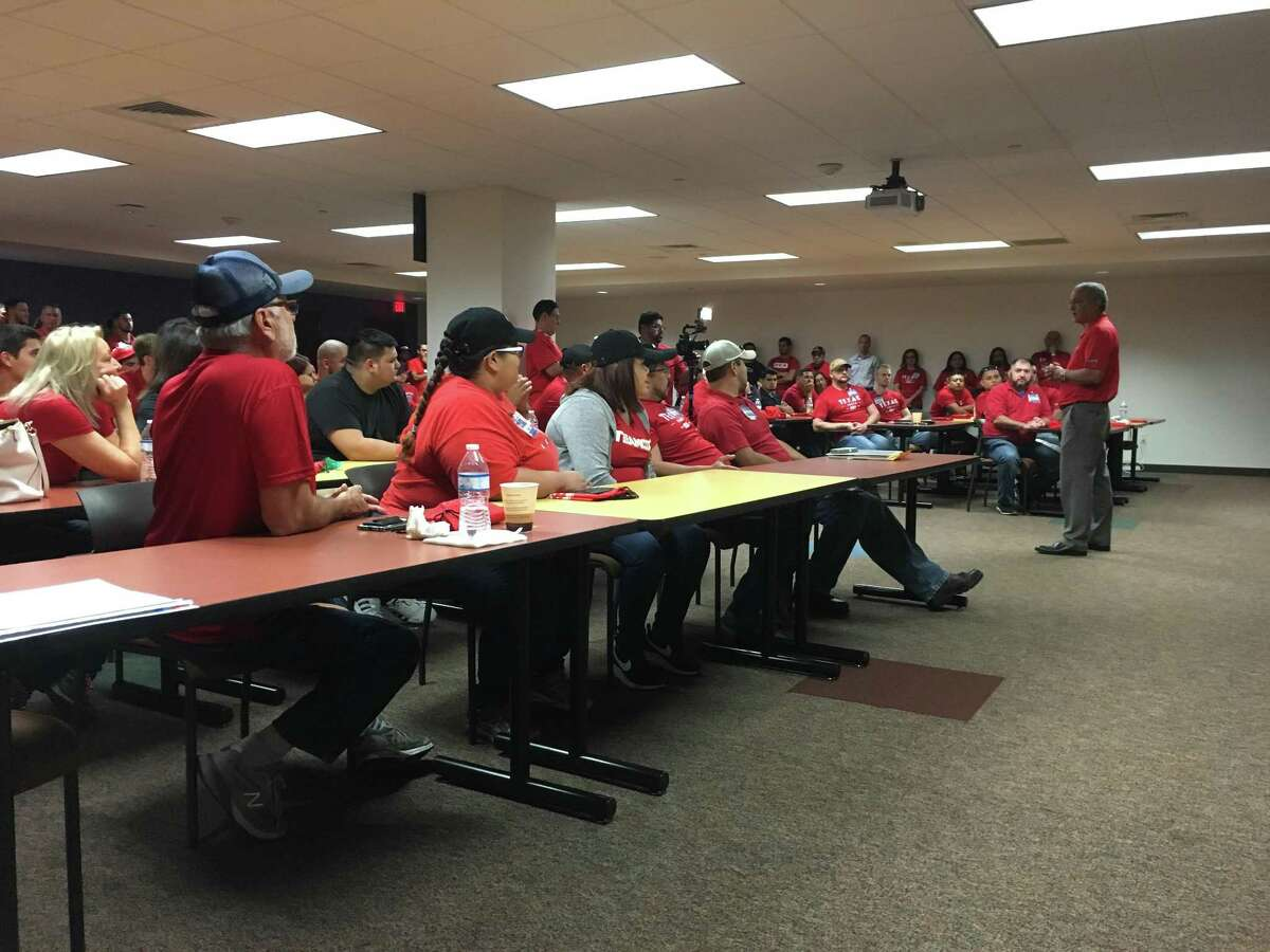 Greg Souquette, H-E-B senior vice president and general manager for the San Antonio region, addresses about 100 H-E-B employees at the company's offices at 1222 N. Main Ave. on Aug. 31, 2017.