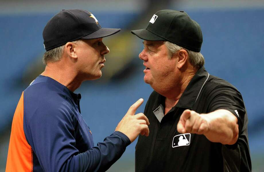 Houston Astros manager A.J. Hinch, left, argues with umpire Joe West after George Springer was called out at second base on a batter interference call during the first inning of a baseball game Thursday, Aug. 31, 2017, in St. Petersburg, Fla. Hinch was tossed from the game by West. (AP Photo/Steve Nesius) Photo: Steve Nesius, Associated Press / FR69810 AP
