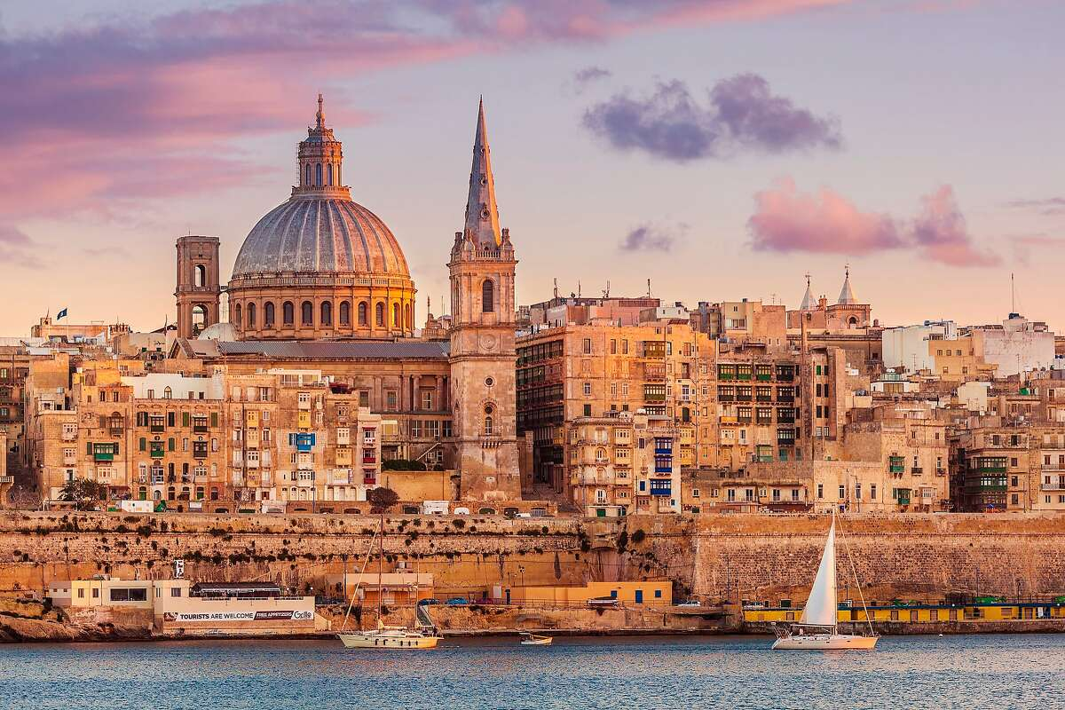 MALTA: Valletta is the capital of the island nation known for its honey-yellow stone architecture, museums and rich history. Shown here are the Carmelite Church dome and St. Paul's Anglican Cathedral.