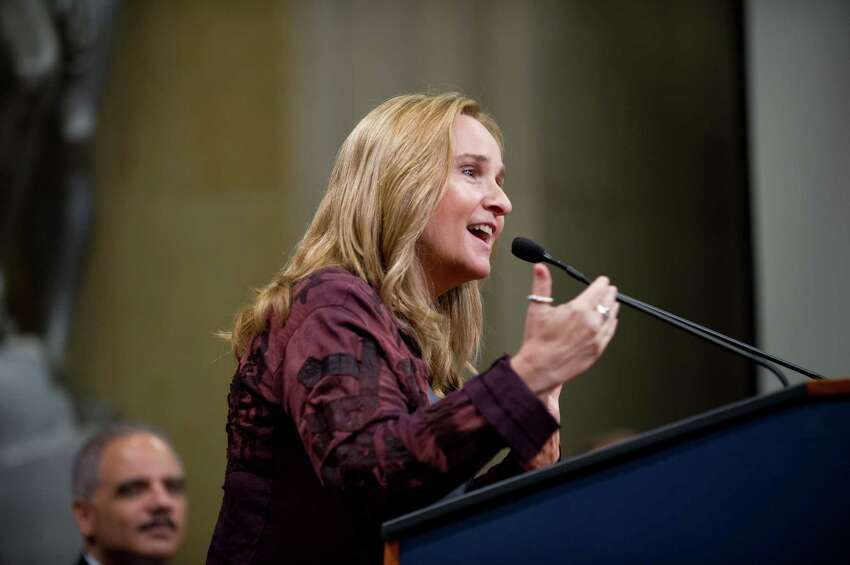 US singer/songwriter and gay rights activist Melissa Etheridge speaks at the Justice Department's Lesbian, Gay, Bisexual and Transgender (LGBT) Pride Month event at the Justice Department in Washington,DC on June 18, 2013. On left, is US Attorney General Eric Holder. AFP PHOTO/Nicholas KAMMNICHOLAS KAMM/AFP/Getty Images