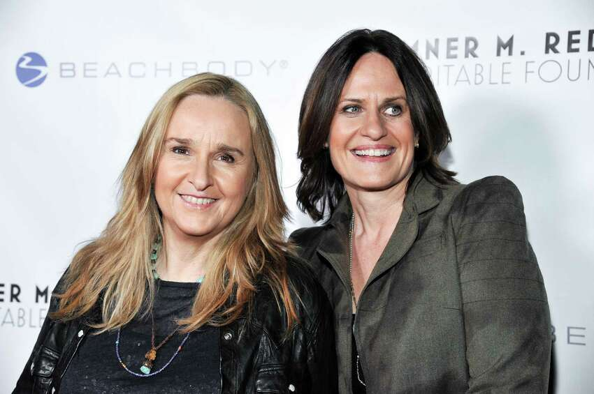 FILE - Melissa Etheridge, left, and Linda Wallem arrive at the 6th Annual Go Go Gala at the Bel Air Bay Club in this Nov. 14, 2013 file photo taken in Pacific Palisades, Calif. People magazine says the 53-year-old Etheridge married partner Linda Wallem at the San Ysidro Ranch in Montecito, California, on Saturday May 31, 2014. (Photo by Richard Shotwell/Invision/AP, File) ORG XMIT: NY109