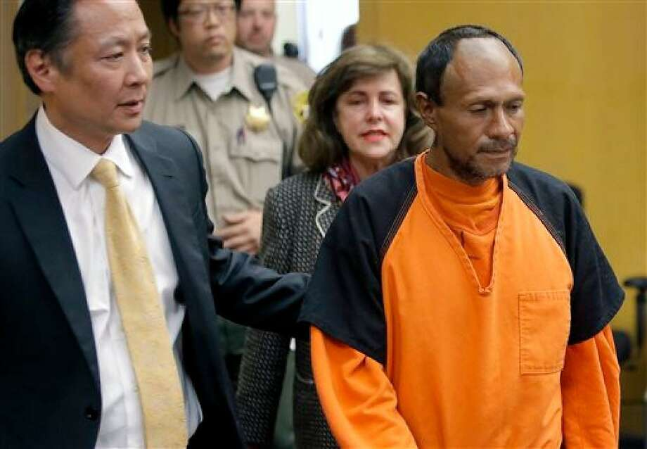 Public Defender Jeff Adachi (left) leads Kate Steinle slaying suspect Jose Ines Garcia Zarate, a.k.a. Juan Francisco Lopez-Sanchez, into court in 2015. Photo: Michael Macor / San Francisco Chronicle 2015 / Michael Macor / The Chronicle 2015