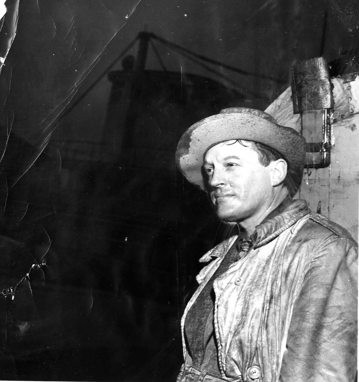 Barney Gould contemplates the sunken Port of Stockton riverboat, he had hoped to convert into a showboat and restaurant, March 12, 1952 Phot ran 3/26/1953, p. 18