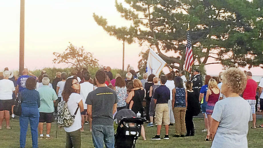 Dozens of people turned at West Haven's Bradley Point Beach early Sunday evening for a ceremony and candlelight vigil in memory of the Sept. 11 attacks. U.S. Sen. Richard Blumenthal, U.S. Rep. Rosa DeLauro and local officials also spoke at the ceremony. Photo: File Photo