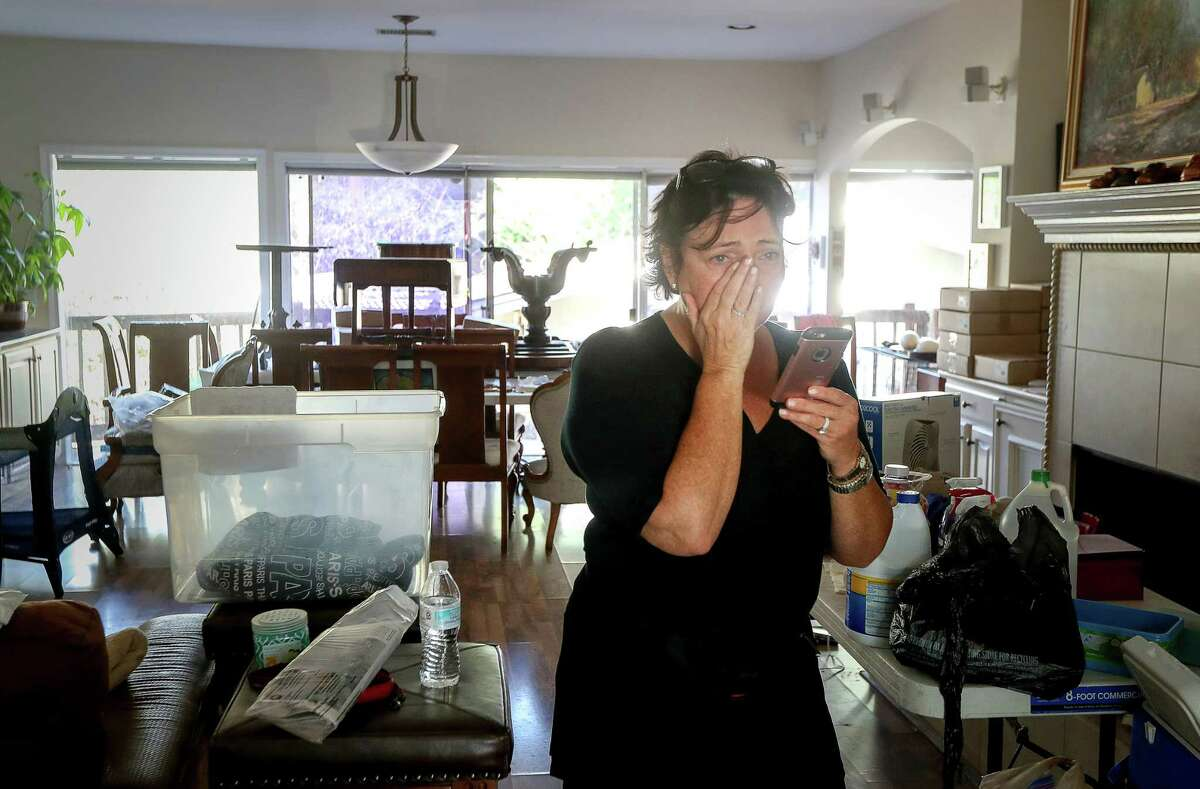 Sharlene Barris begins to cry after seeing HFD Capt. Joshua Vogel, not pictured, while firefighters were doing welfare checks on residents in the Meyerland area, Thursday, Aug. 31, 2017, in Houston. Vogel's team evacuated Barris and her husband as waters rose into their home.