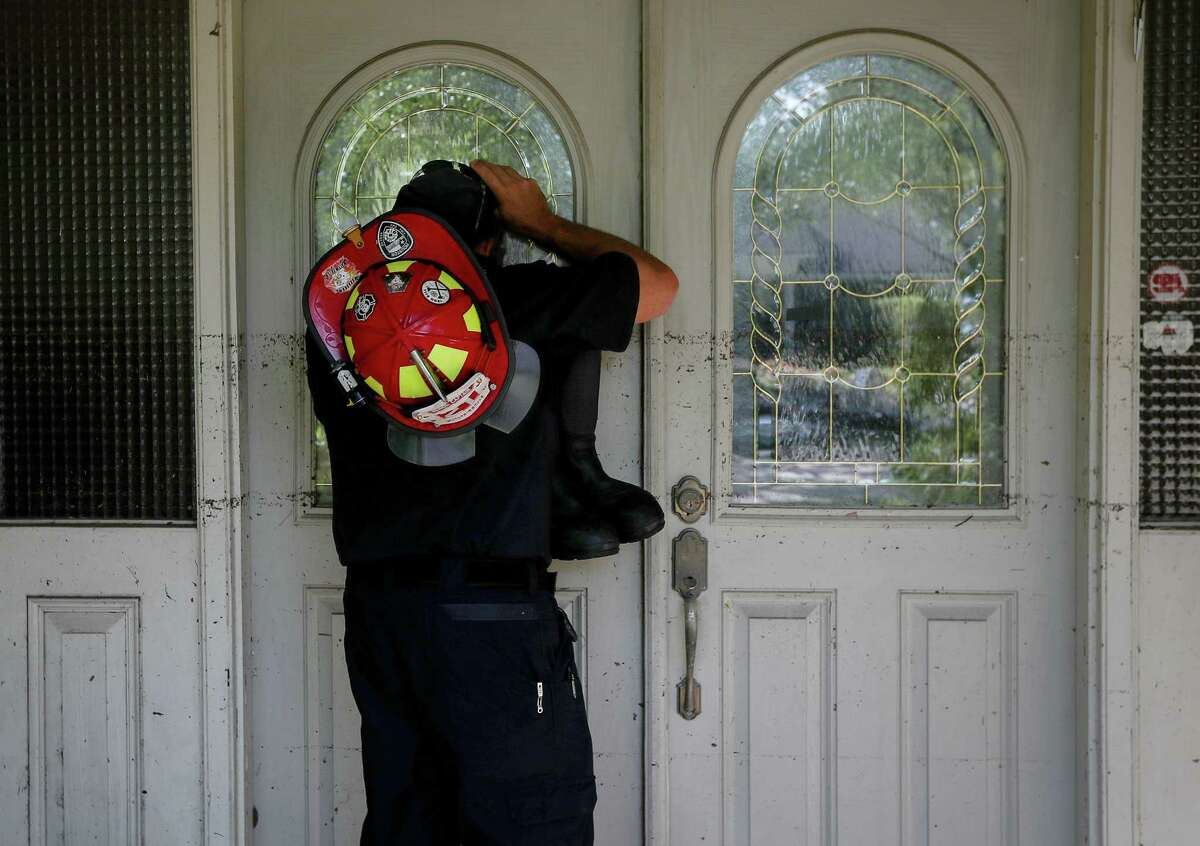 HFD Capt. Joshua Vogel checks a house with a high waterline while doing welfare checks on residents in the Meyerland area, Thursday, Aug. 31, 2017, in Houston.