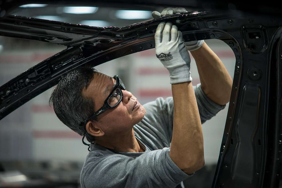 FEBRUARY 4, 2015 FREMONT, CA Workers assemble cars on the line at Tesla's factory in Fremont. David Butow (Photo by David Butow/Corbis via Getty Images)