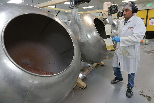 Steve Ortiz, 23, adds gum Arabic to a batch of chocolate candies at Kimmie Candy Company, Wednesday, May 14, 2014. The candy company was founded in 2000 by Joseph Dutra and is one of many business and industries in the Reno, Nevada area. Nevada is in competition with Texas along with three other states for a $5 billion Tesla Gigafactory. It will produce lithium batteries for its vehicles. Tesla is expected to announce and break ground at a site in early June. The factory is expected to employ 6,000.
