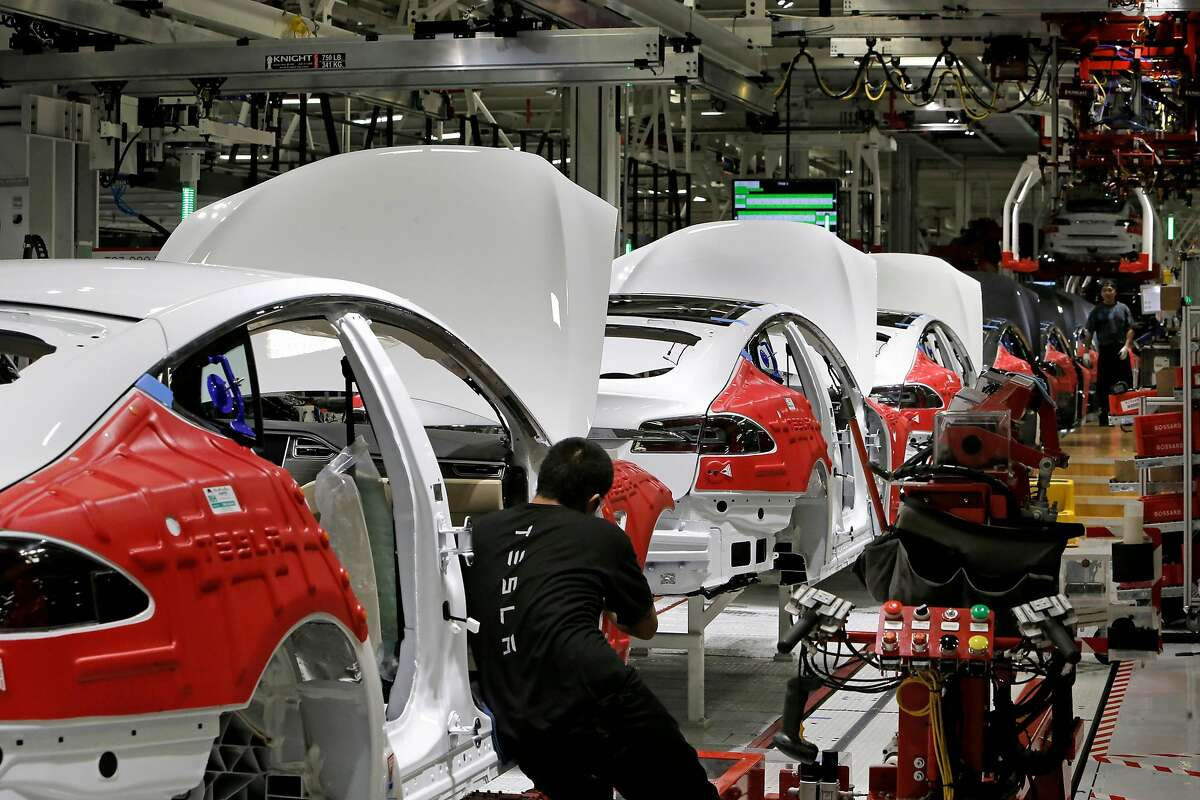 Cars move through the assembly line at Tesla Motors, California's only full-scale auto manufacturing plant, as seen on Thurs. Feb. 19, 2015, in Fremont, Calif.
