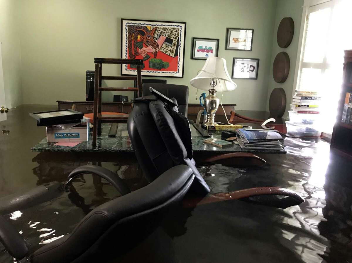 The Meyerland home of Janus and John Lazaris flooded during Tropical Storm Harvey.