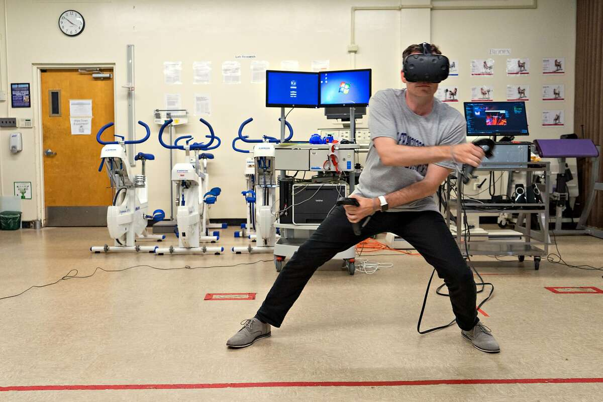 Aaron Stanton exercises using a virtual reality headset at San Francisco State University on Monday, Aug. 21, 2017. Researchers at the university are studying how effective exercising using virtual reality can be.