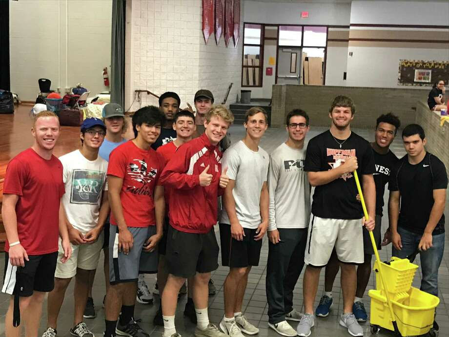 Student athletes from Hargrave High School helped mop the floors and performed various other tasks at the Tropical Storm Harvey shelter at Copeland Elementary School in Huffman Photo: Mike McEachern