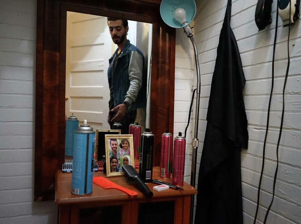 An aspiring hairdresser, Mohammad Shanif, Safeih's son, has converted a closet in his family's Albany apartment into a makeshift hair salon to service friends and family.