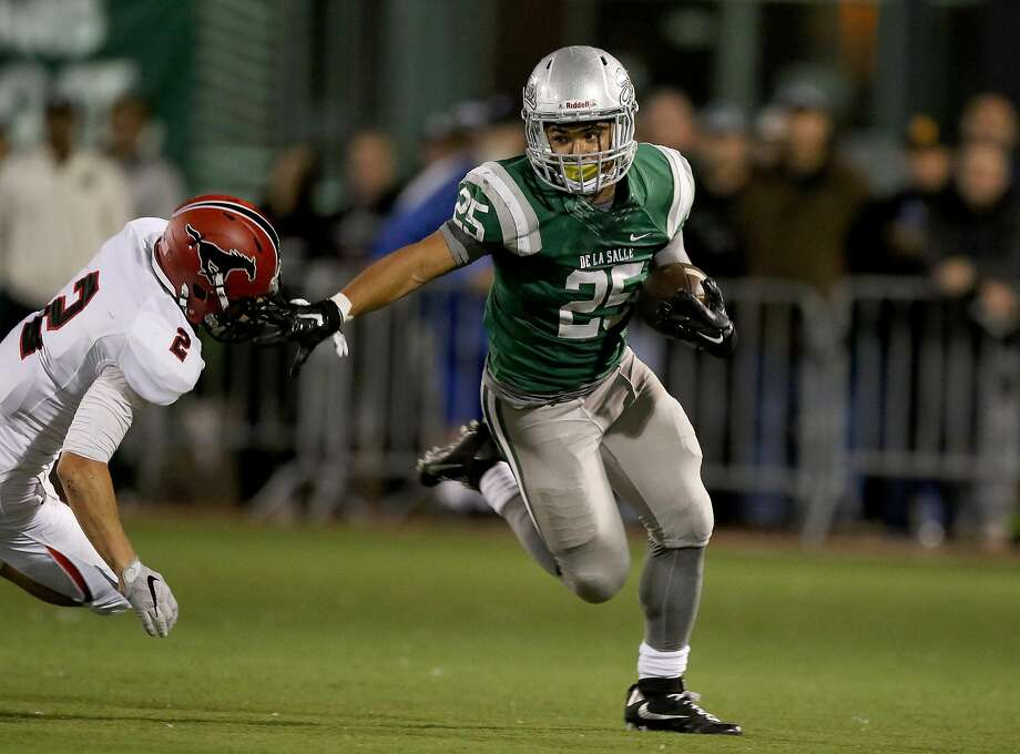 De La Salle senior running back Kairee Robinson won't shoulder as much of the offensive as he did in his junior year, in part because his responsibilities on the defensive side of the ball are increasing. Photo: Dennis Lee, MaxPreps
