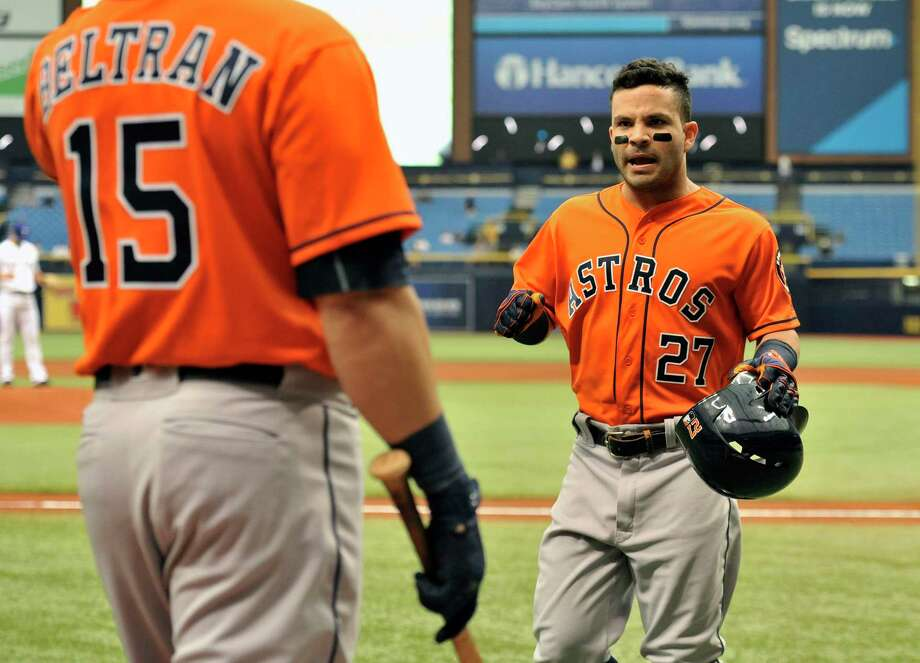 Houston Astros on-deck batter Carlos Beltran (15) greets Jose Altuve after his solo home run off Texas Rangers starter Nick Martinez, right, during the first inning of a baseball game Thursday, Aug. 31, 2017, in St. Petersburg, Fla. (AP Photo/Steve Nesius) Photo: Steve Nesius, FRE / FR69810 AP