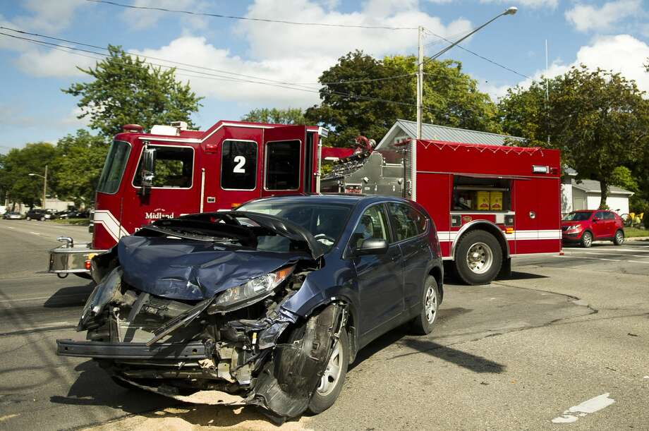 Traffic is directed around the site of a collision between two vehicles at the intersection of Ashman and Indian on Thursday, August 31, 2017 in Midland. Neither driver sustained significant injury in the collision. Photo: (Katy Kildee/kkildee@mdn.net)