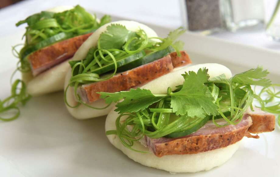 Pork belly steam buns with hoisin, cilantro, sriracha, cucumber and scallion at Ronnie & Ralphie's on Phila St. Monday, Aug. 28, 2017 in Saratoga Springs, N.Y. (Lori Van Buren / Times Union) Photo: Lori Van Buren / 20041382A
