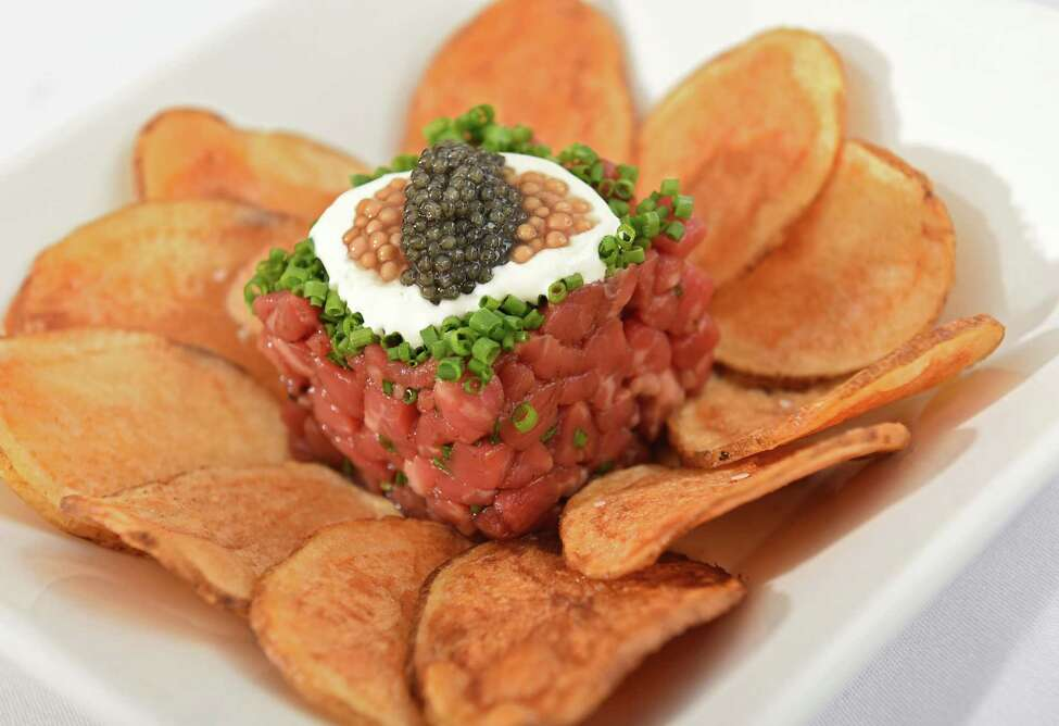 American Wagyu beef tartare with ponzu, caviar, creme fraiche, pickled mustard seed and Saratoga chips at Ronnie & Ralphie's on Phila St. Monday, Aug. 28, 2017 in Saratoga Springs, N.Y. (Lori Van Buren / Times Union)