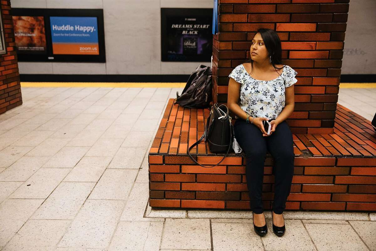 Joseline Gonzalez waits for the BART train at 12th St. Oakland City Center Station in Oakland, Calif. Thursday, August 31, 2017.