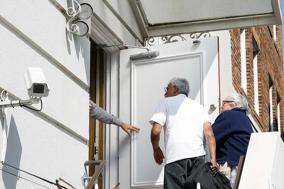 Visitors with an appointment come to the Russian consulate for passport related issues on Wednesday, August 30, 2017, in San Francisco, Calif., as the Russian consulate will be closing  tomorrow.