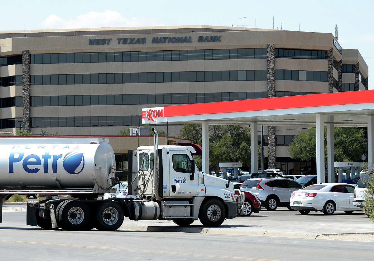 A tanker truck hauling fuel is forced to drive over a curb to get into a gas station at the corner of Wadley and Big Spring after Midland drivers crowded gas stations across the city in response to rumors of a possible gas shortage in the aftermath of Hurricane Harvey, Aug. 31, 2017. James Durbin/Reporter-Telegram