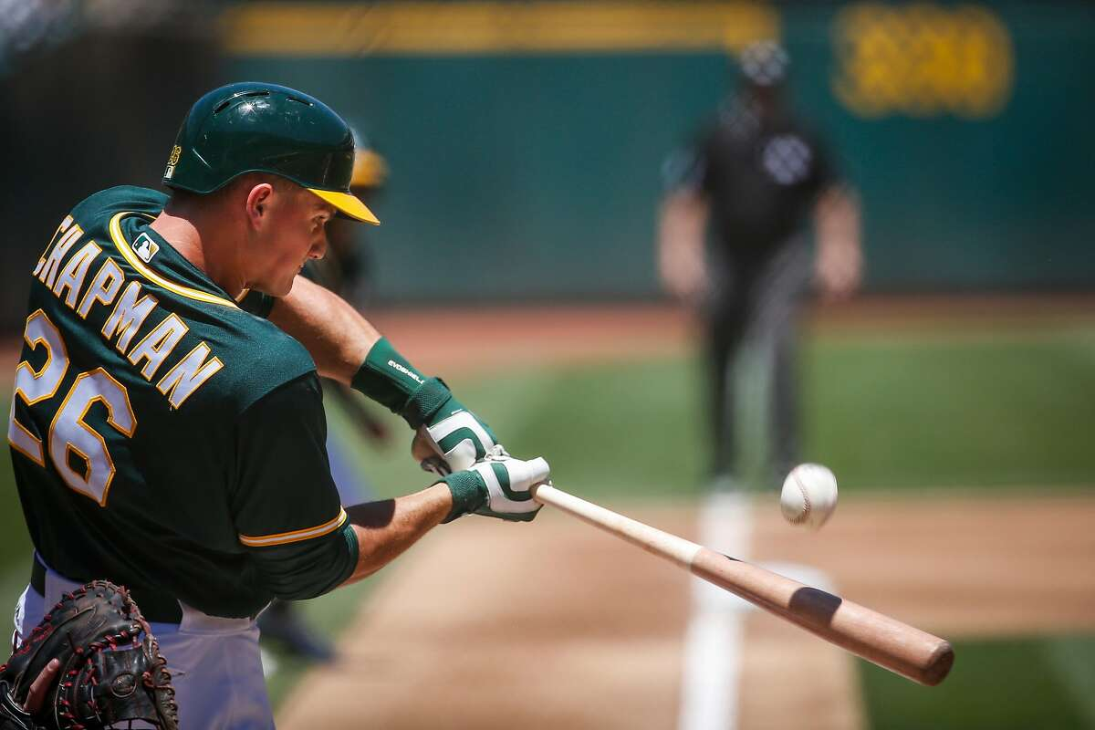 Oakland Athletics third baseman Matt Chapman (26) connects with the ball during the game against the Cleveland Indians at the Oakland Alameda Coliseum in Oakland on Sunday, July 16, 2017. The Athletics won 7 to 3.
