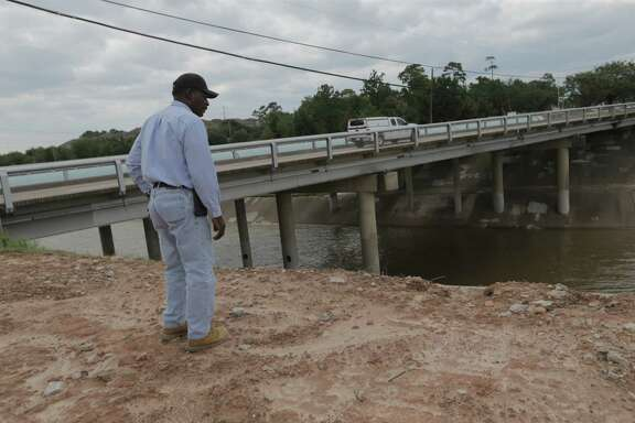 Houston Flood Control inspector Bobby Arnold walks along the White Oak Bayou by T.C. Jester Blvd in Houston  Wednesday, Aug. 30, 2017, in Houston.