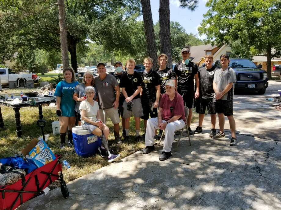 The Conroe Tigers baseball program volunteered in the River Plantation community on Thursday by helping residents clean out damaged materials from their flood-ravaged homes. Photo: Jeff Raymer