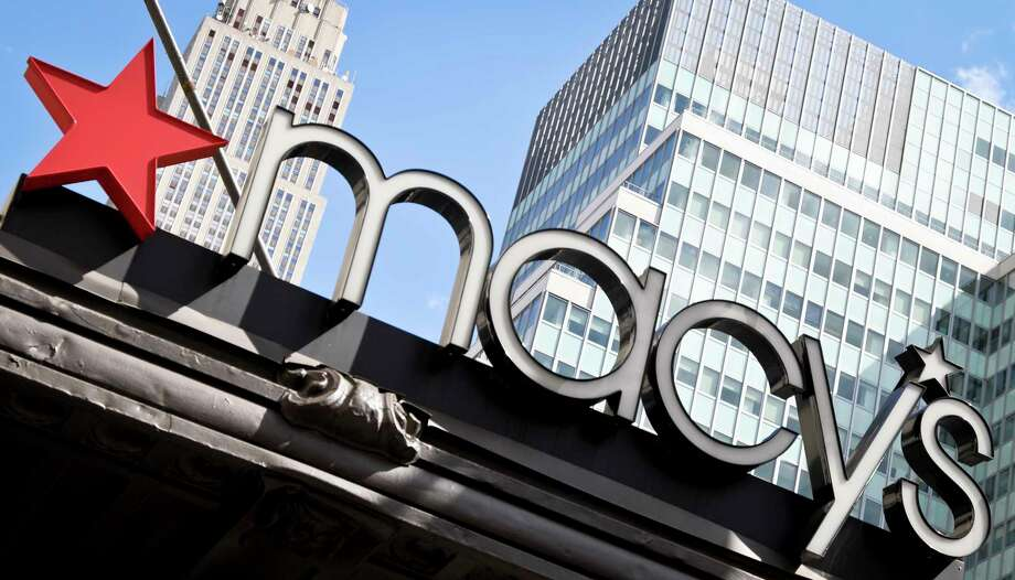 This Tuesday, May 2, 2017, photo shows Macy's corporate signage at its flagship store in New York. Macy's and Best Buy are expanding their same-day delivery as they aim to become more competitive with online leader Amazon. (AP Photo/Bebeto Matthews) ORG XMIT: NYBM602 Photo: Bebeto Matthews / Copyright 2017 The Associated Press. All rights reserved.