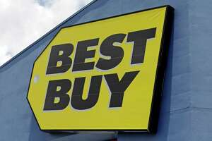 This Monday, May 22, 2017, photo shows a Best Buy sign at a store in Hialeah, Fla. Macy's and Best Buy are expanding their same-day delivery as they aim to become more competitive with online leader Amazon. (AP Photo/Alan Diaz) ORG XMIT: FLAD309