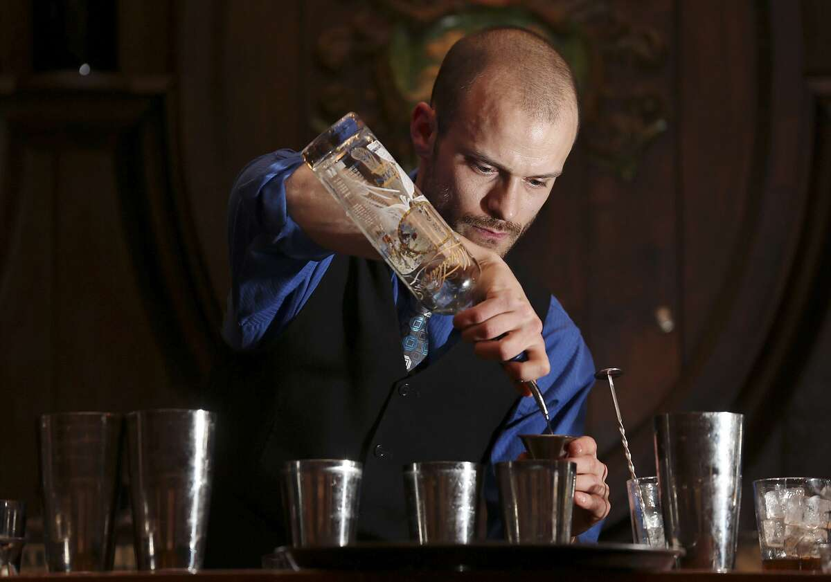 Rob Gourlay prepares cocktails during the Sasha Petraske's Skills Competition part of the San Antonio Cocktail Conference in 2013.