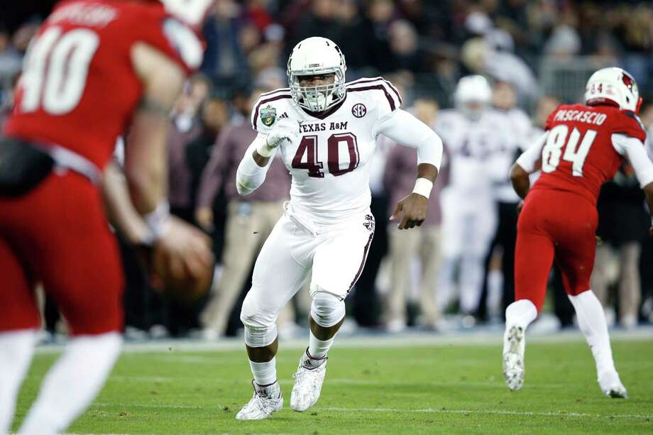 NASHVILLE, TN - DECEMBER 30: Jarrett Johnson #40 of the Texas A&M Aggies in action against the Louisville Cardinals during the Franklin American Mortgage Music City Bowl at Nissan Stadium on December 30, 2015 in Nashville, Tennessee. Louisville defeated Texas A&M 27-21. (Photo by Joe Robbins/Getty Images) Photo: Joe Robbins, Contributor / 2015 Joe Robbins