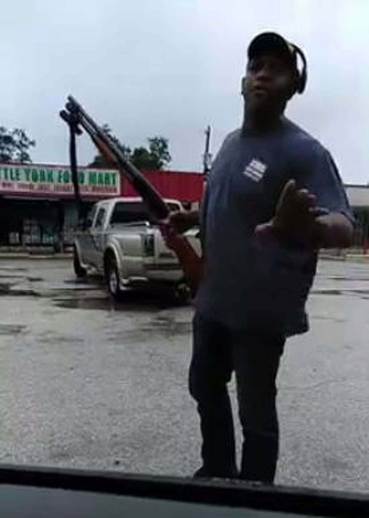 Nash John of Houston has become viral after a Facebook video showed him fighting off would-be looters from a Little York Food Mart in North Harris County with a shotgun on Aug. 8, 2017.