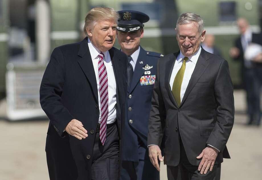 Defense Secretary Jim Mattis (right) is slow-walking Trump's ban on transgender troops. Photo: SAUL LOEB, AFP/Getty Images